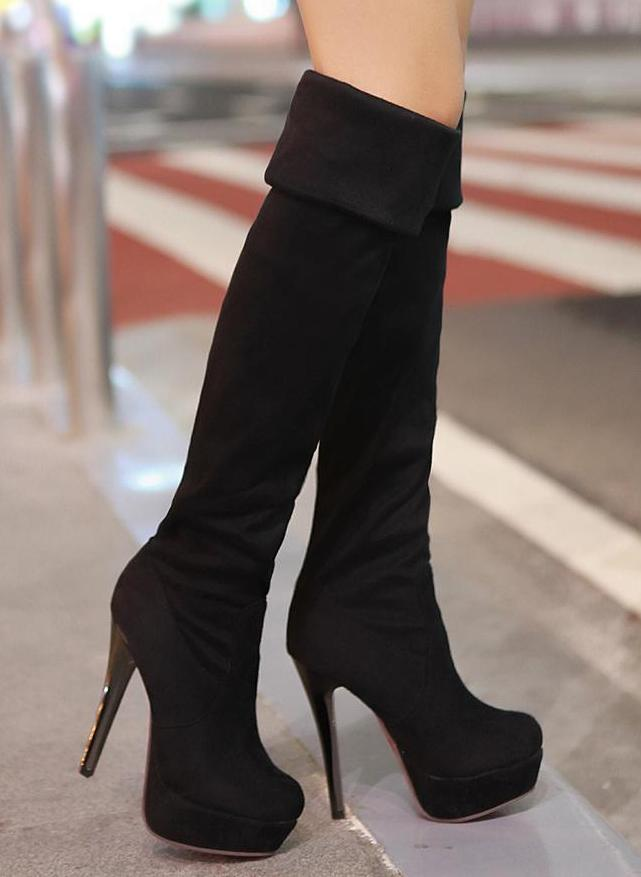 how to expertly walk in black high heel boots carey fashion