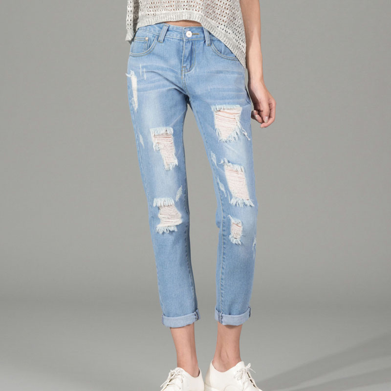 Women In Ripped Jeans - Xtellar Jeans