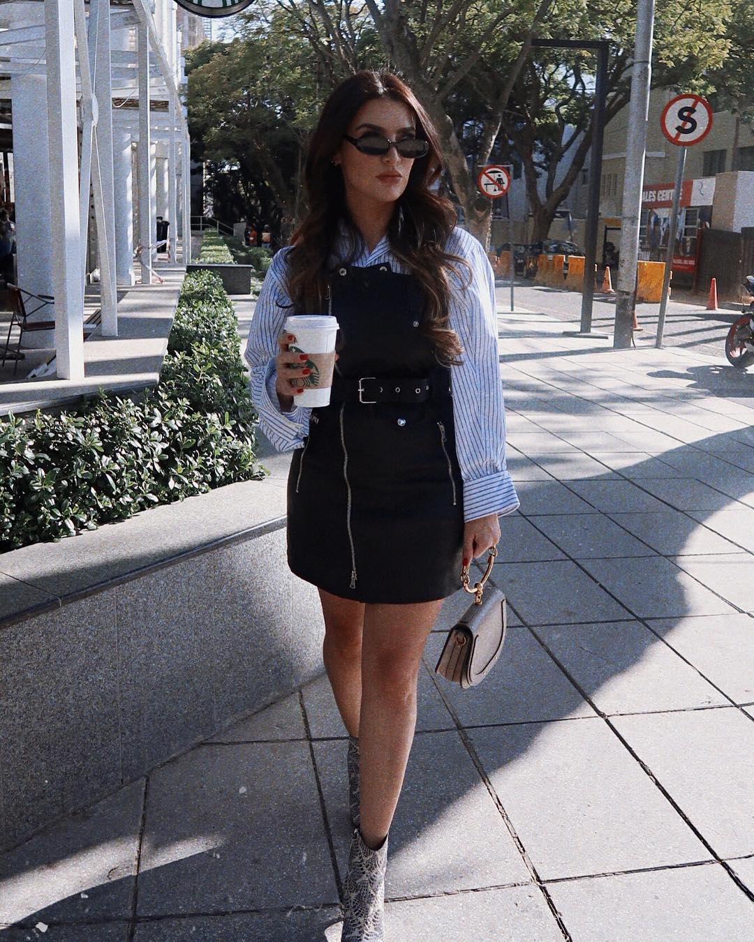 Black biker style zip dress and oversized striped white shirt combo 2021