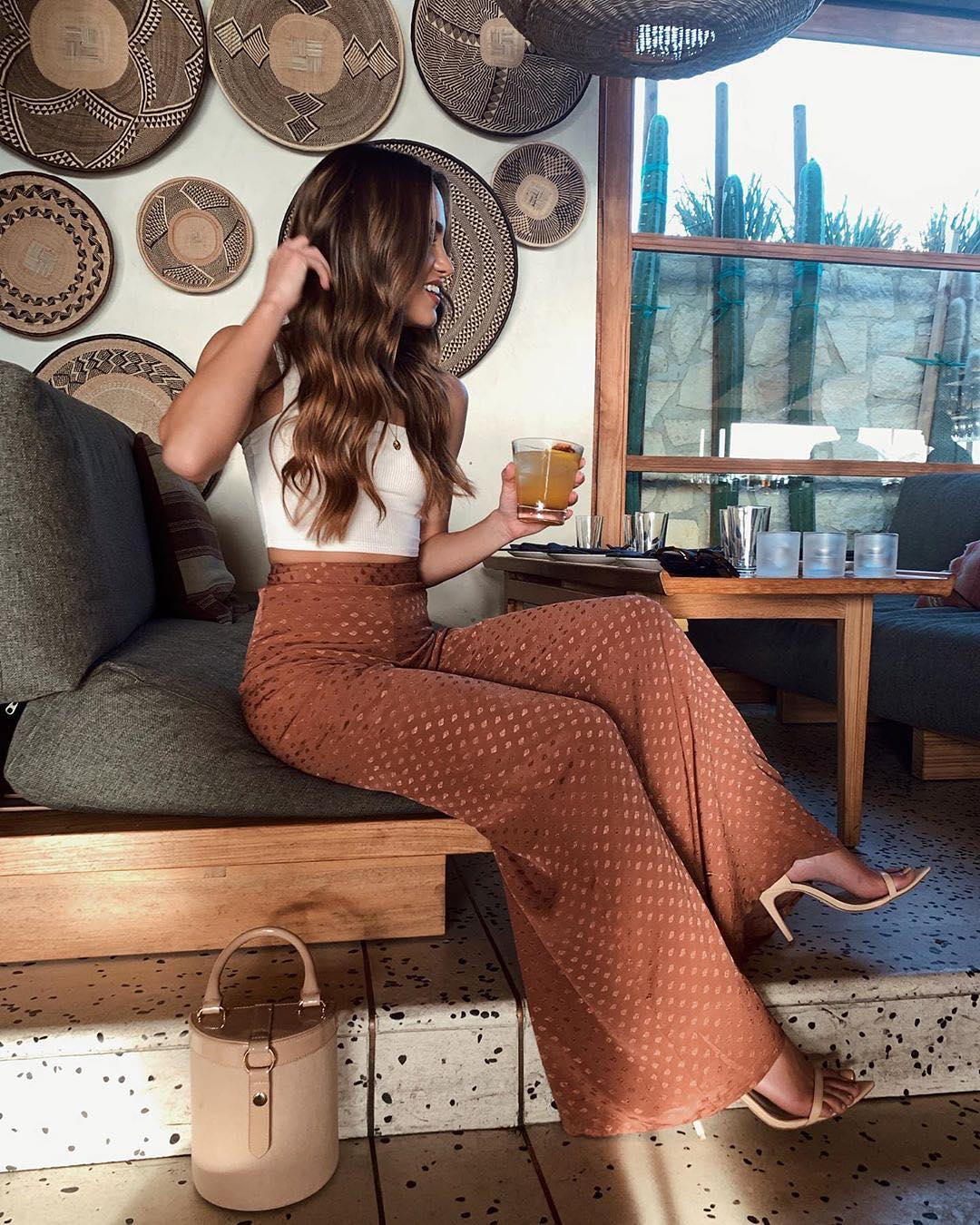 Boho Inspired Seventies Look with a white top and wide leg trousers 2021