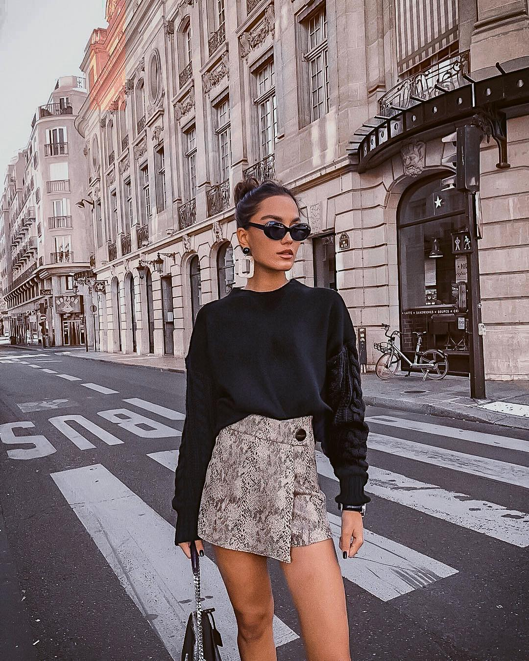 Bulky sweater in black and wrap-around mini skirt for fall 2021