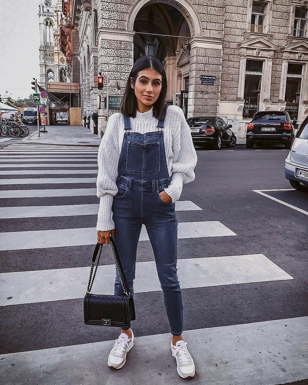 Casual athletic basics: denim overalls, white sweater and white sneakers 2021
