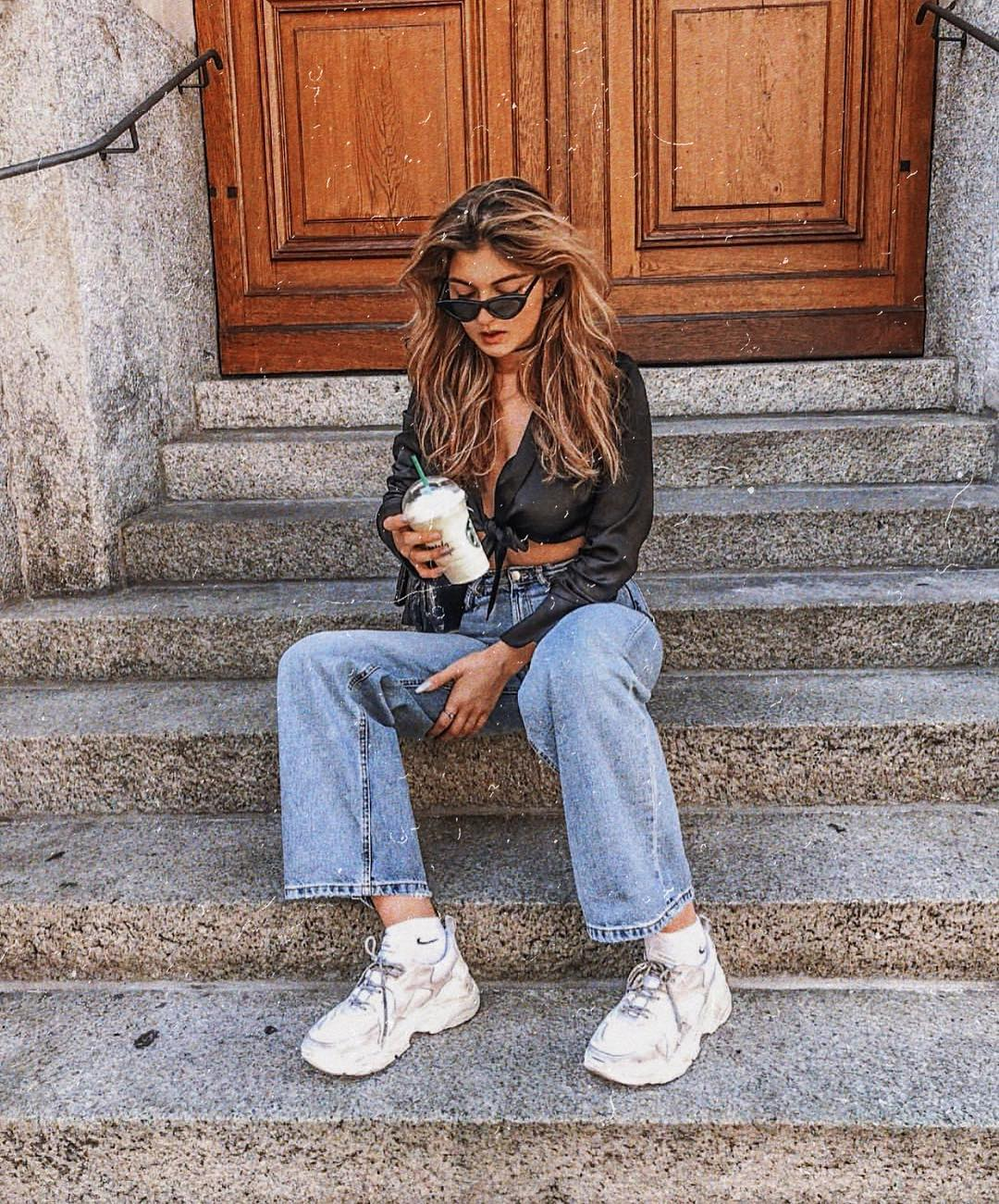 Casual summer basics: silk black crop blouse, boyfriend jeans and chunky trainers in white 2021