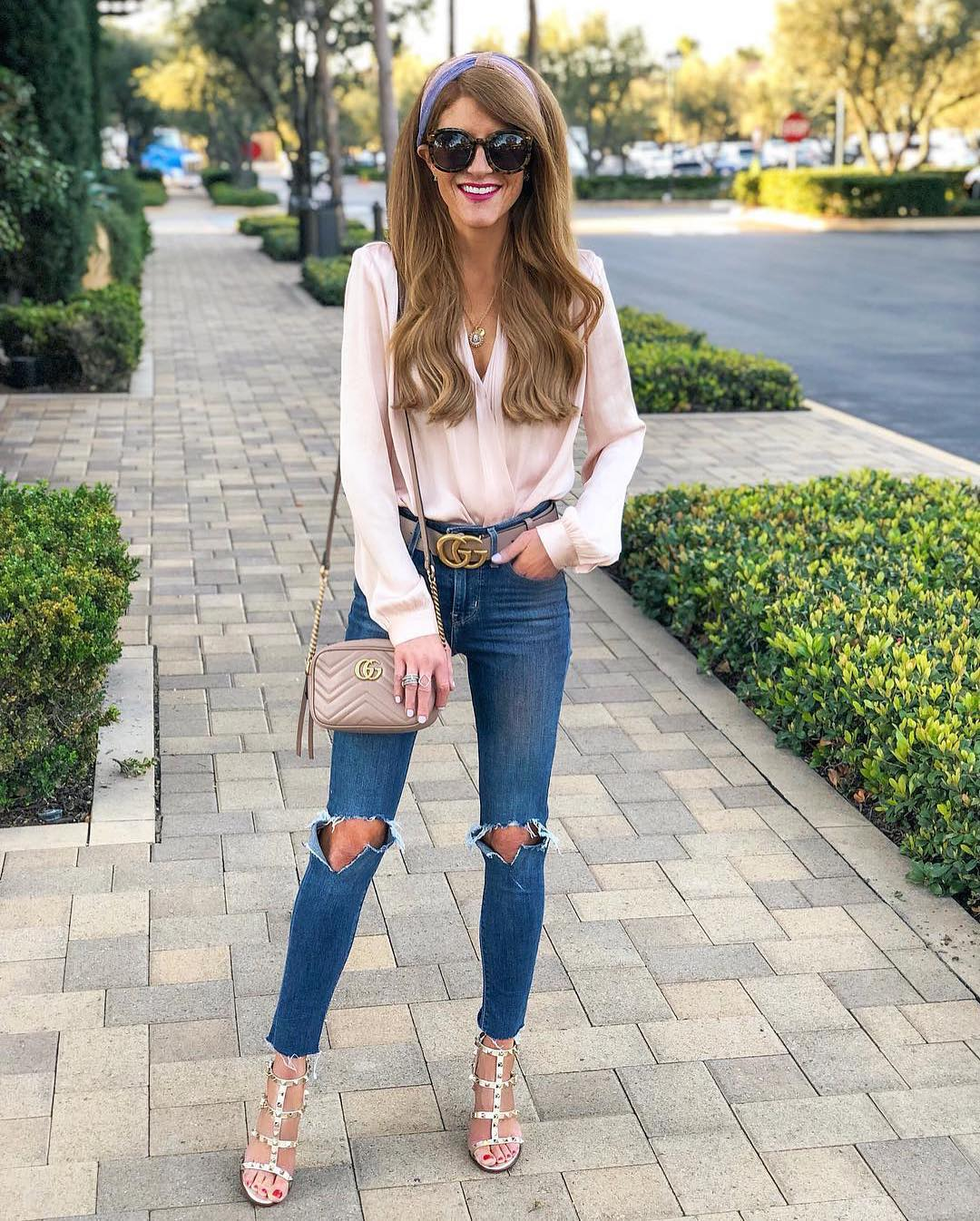 Cream blush blouse and knee ripped blue jeans for weekend parties 2021