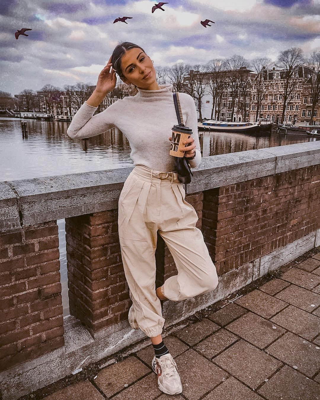 Cream gray sweater and gathered beige pants with sneakers for fall 2021