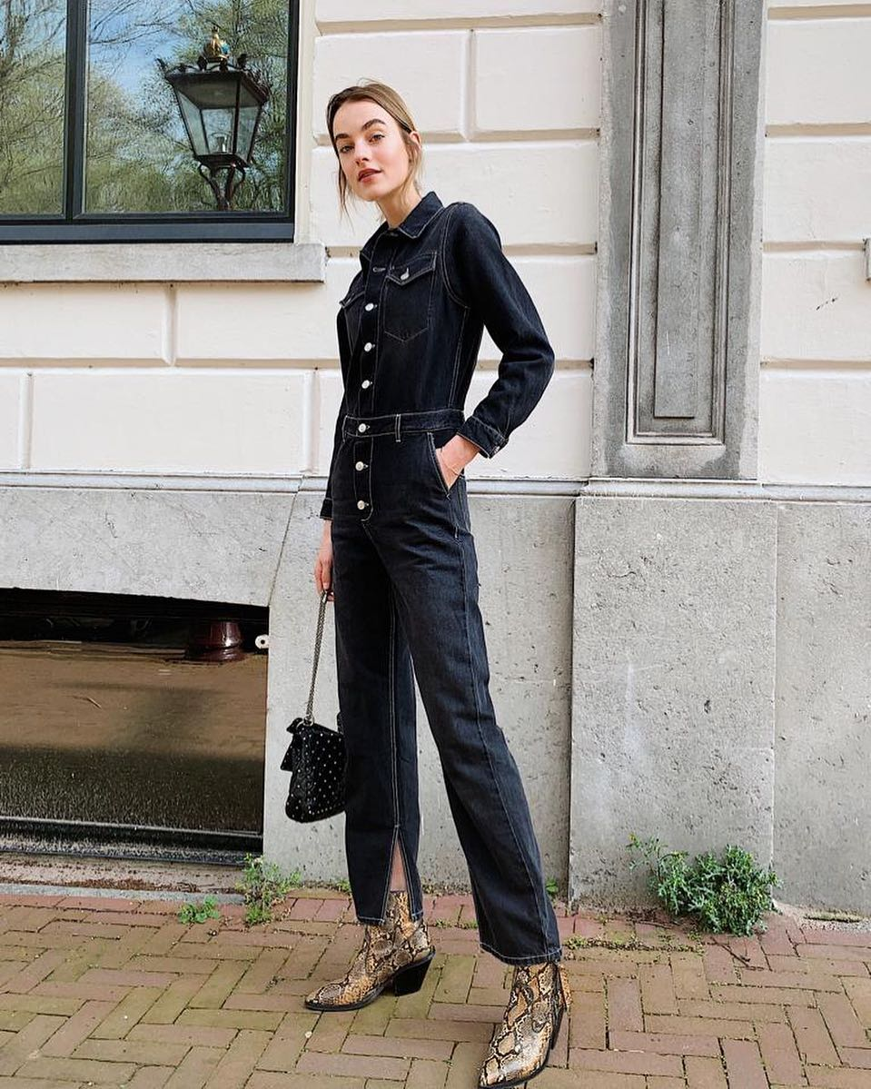 Dark navy denim jumpsuit and snakeskin boots for spring 2021