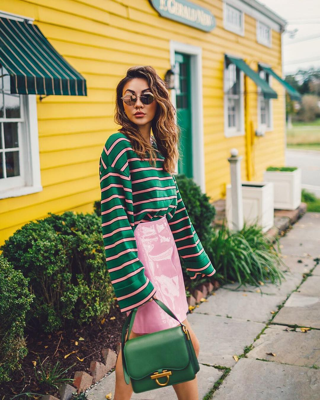 Green and pink striped top and lacquered pink skirt for spring 2021