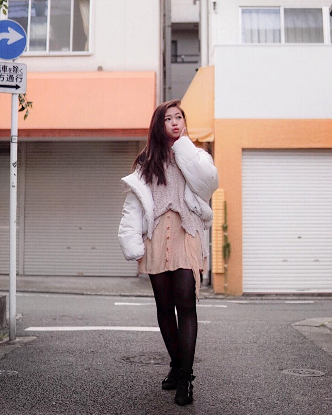Layered hipster look for winter: puffer jacket, peasant dress and sweater 2021