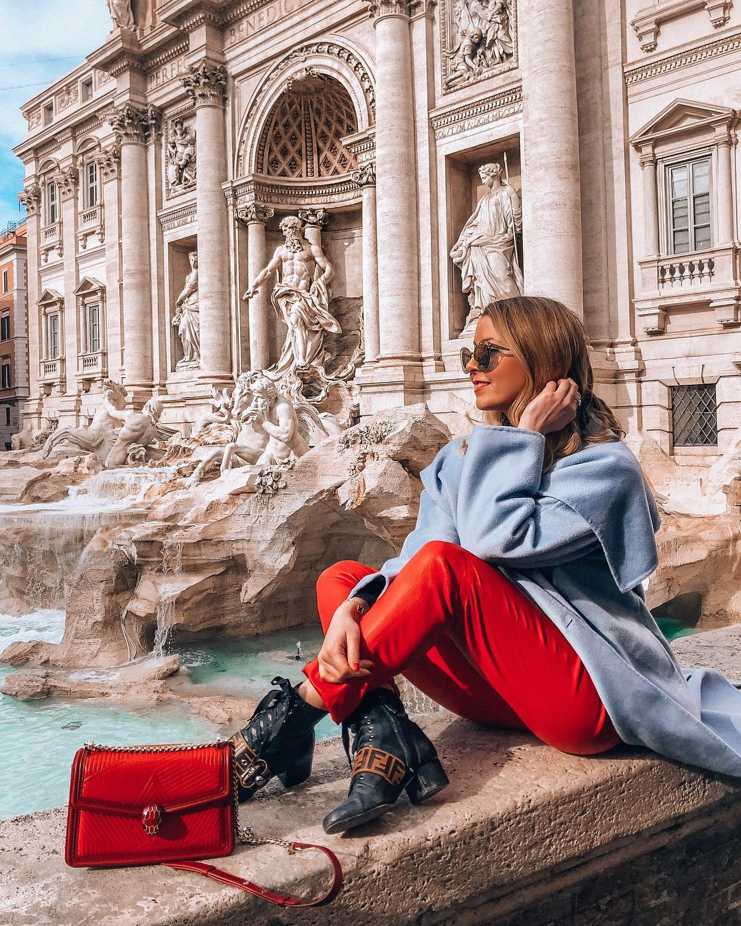 Light blue coat and red trousers for autumn: basic combination for young women 2021