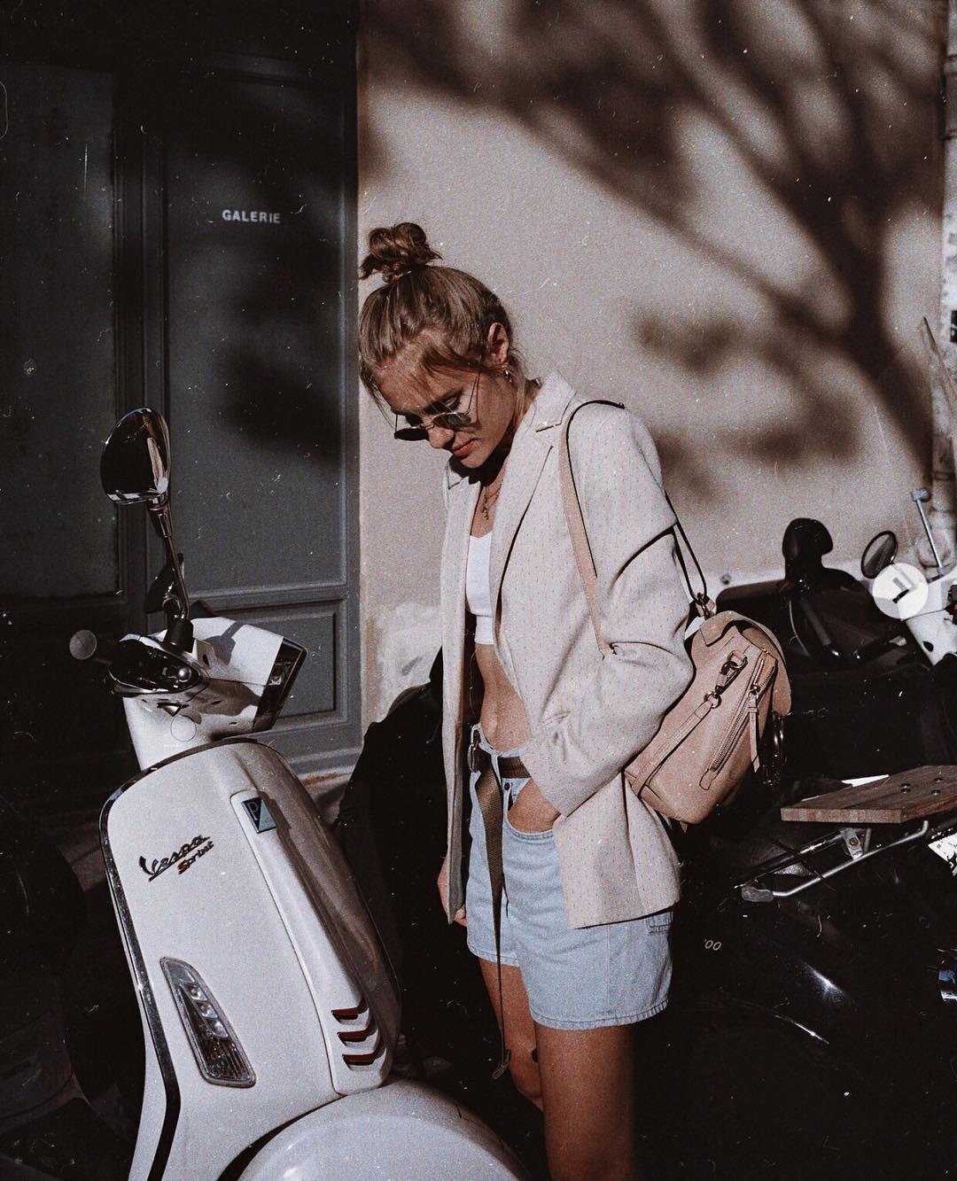 Light gray blazer, white crop top and denim shorts are Summer Basics 2021