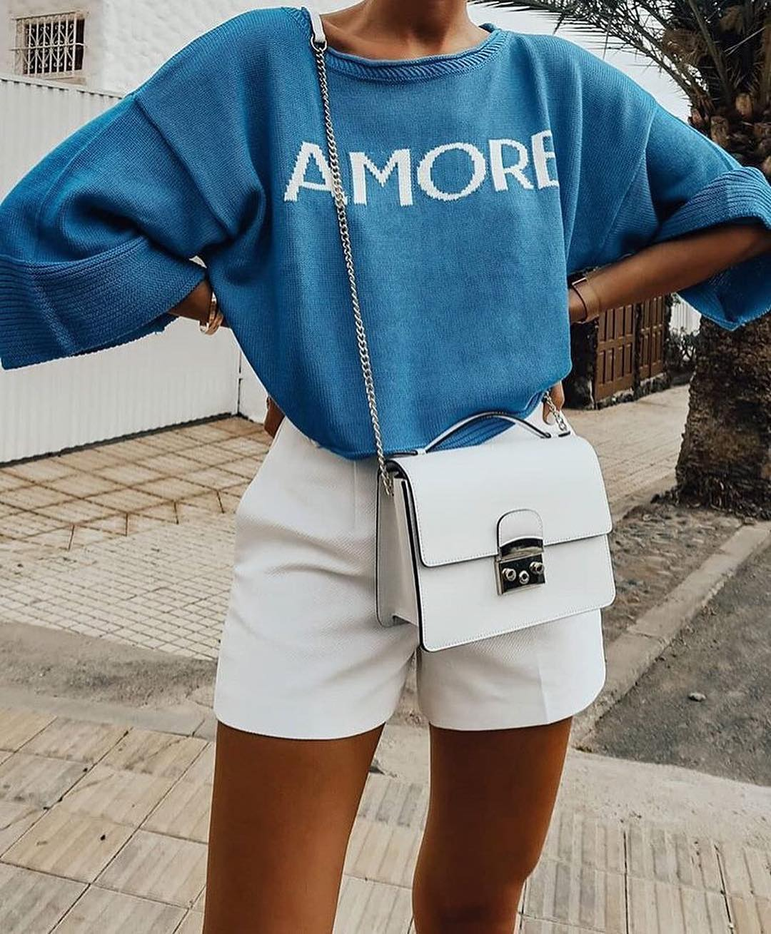Oversized blue sweater and white shorts for spring holiday 2021