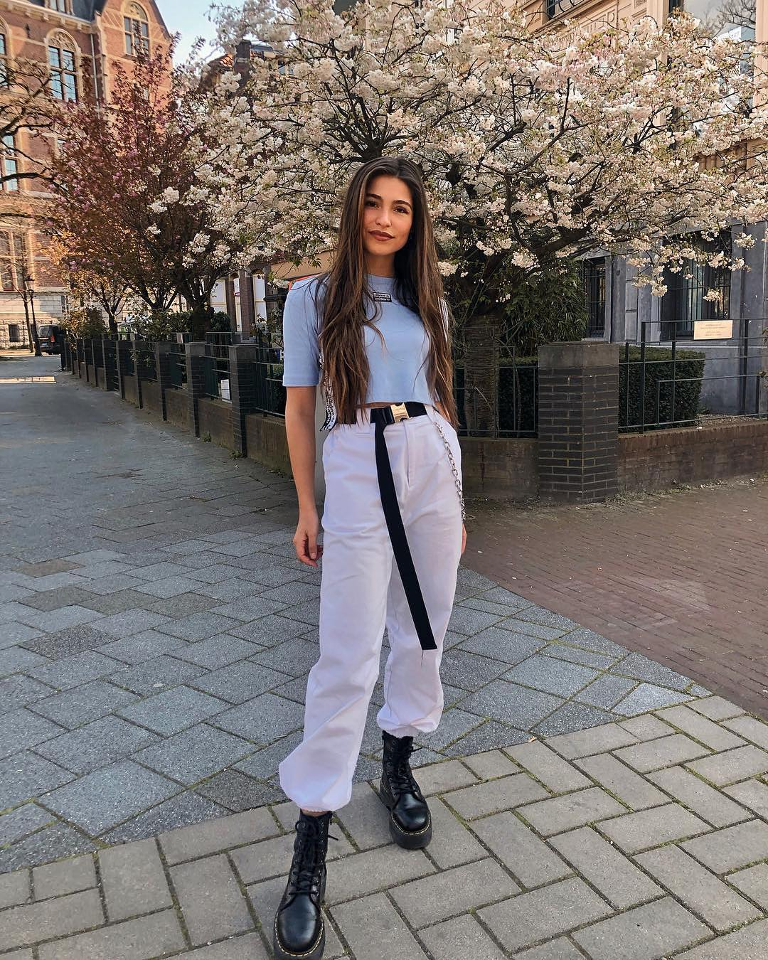 Pastel blue top with white sweatpants and black combat boots for summer 2021