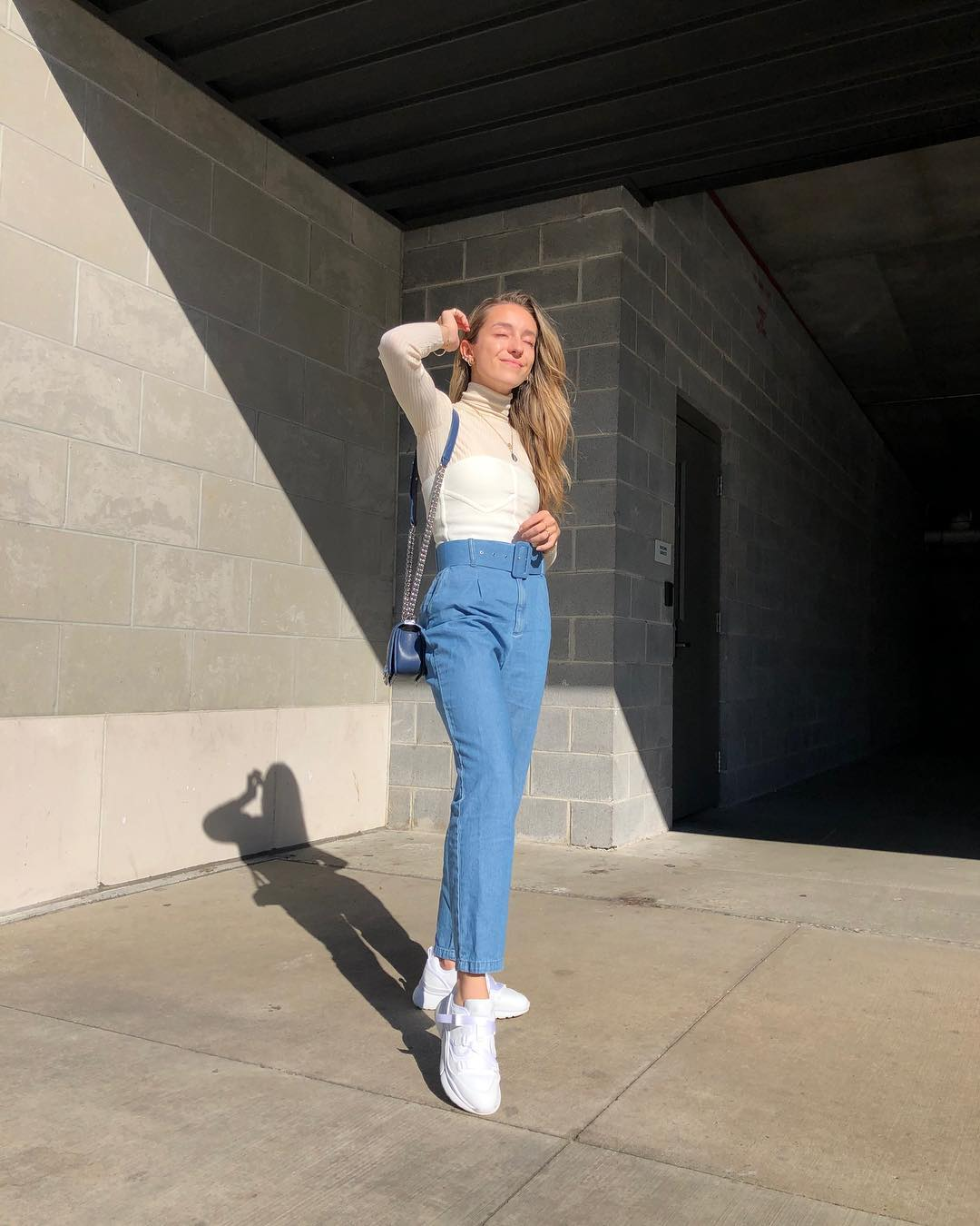 Turtleneck and high-rise jeans with white kicks: Spring Normcore Basics 2021