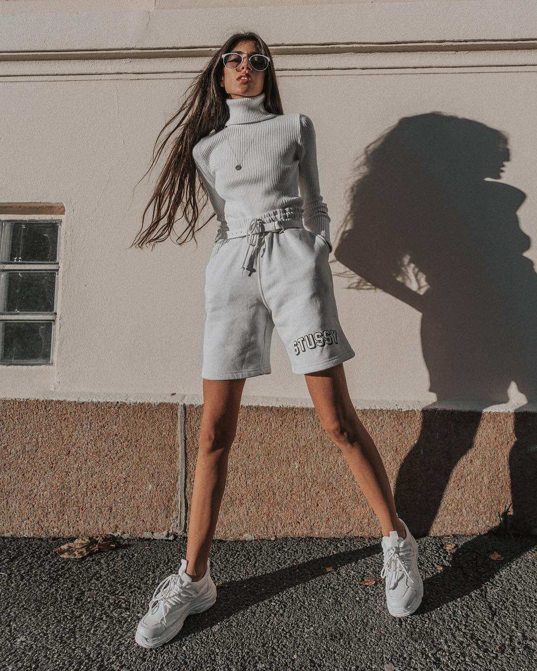Turtlenecks, shorts, sneakers: a monochrome look for spring 2021