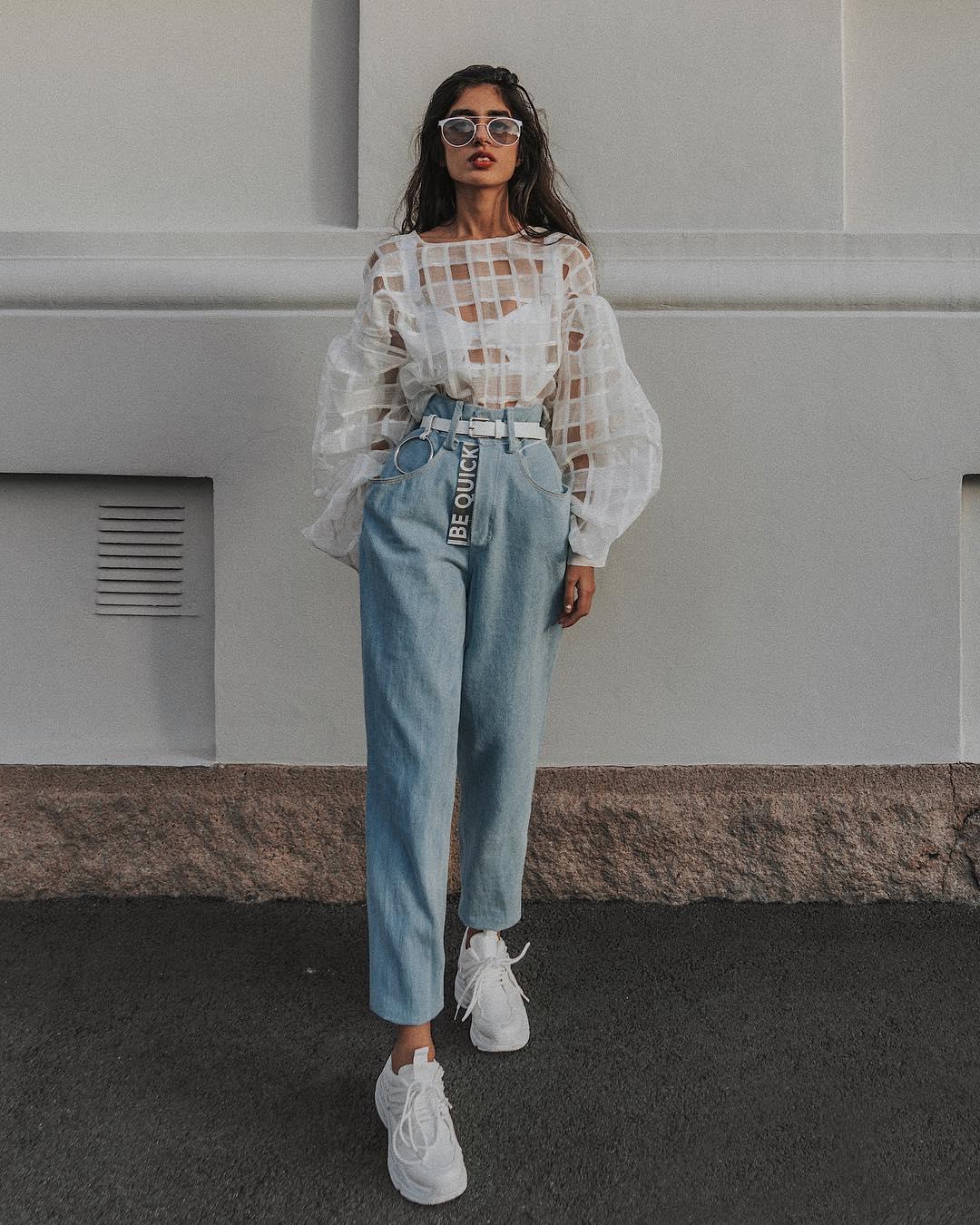White sheer top and light blue regular high-rise jeans: Feminine Normcore Trend 2021