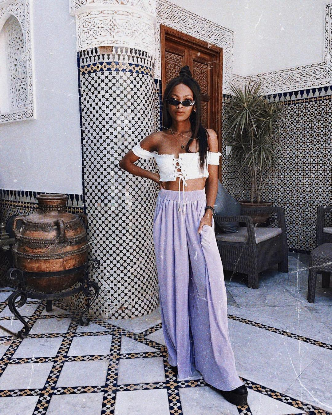 White strapless crop top with pastel purple palazzo pants for summer 2021