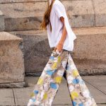 Boho Inspired Seventies Look With White   Top And Wide Leg Pants